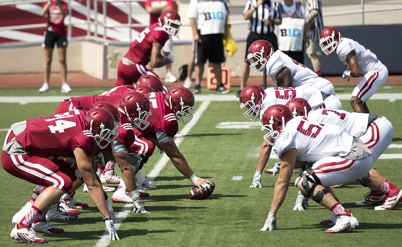 """IU football team's senior captain Nick Mangieri says the defensive front seven, shown here during preseason scrimmage against the highly touted offense, is packed with experience and has """"the attitude that we could be a top defense."""" 