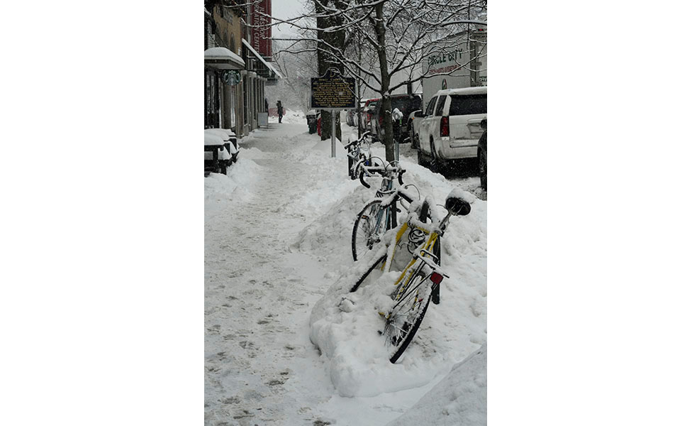 This photo is my favorite of the day. I love the bikes plowed over in snow along Indiana and East Kirkwood avenues and the snow falling while everyday life (deliveries, footprints) continues.  Photo by Ann Georgescu