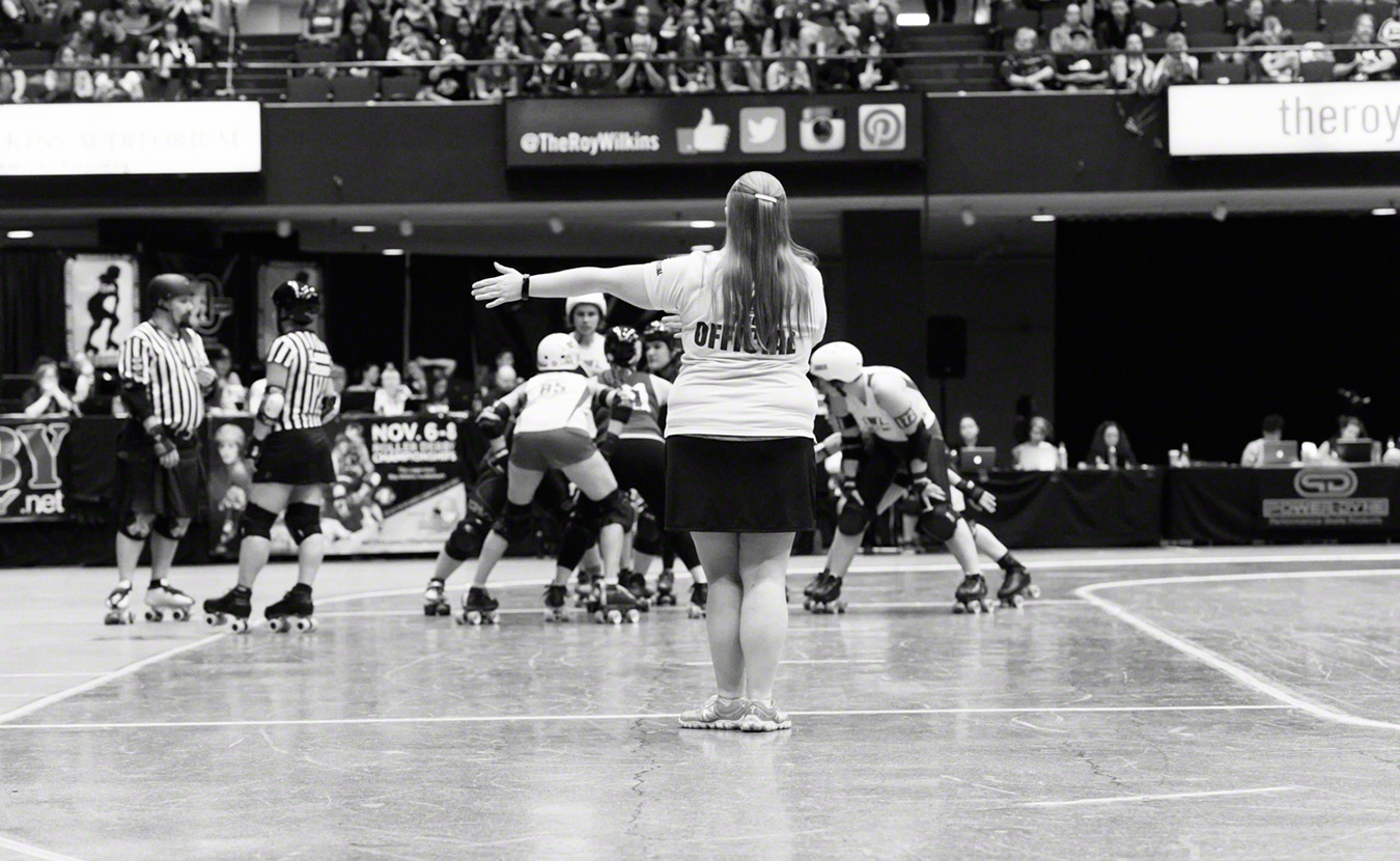 Bekka Potter, whose roller derby name is Silken Tofu, clocks a time out during the Women's Flat Track Roller Derby Association's (WFTDA) Championship Tournament in fall 2015 in St. Paul, Minnesota. Tofu is one of the top four WFTDA-certified Non-Skating Officials (NSOs) in the world. | Photo by Bob Ayers