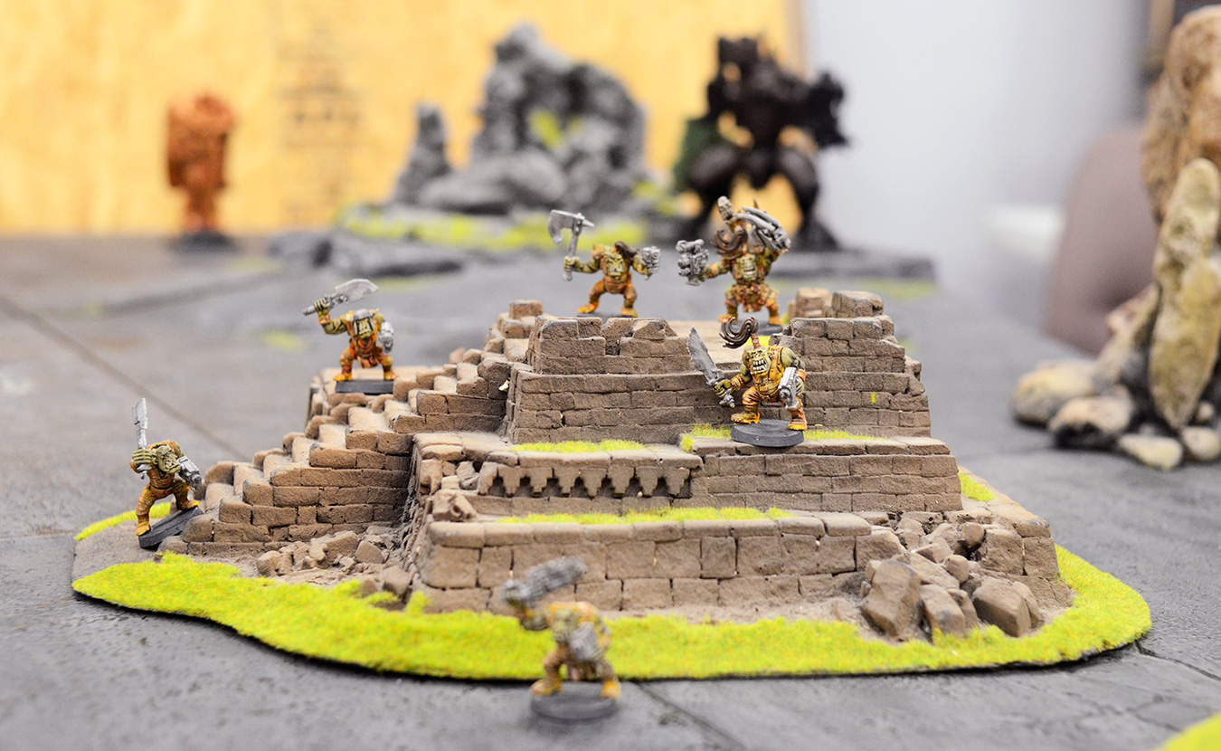 """Orks stand their ground in """"Warhammer 40,000"""" in the downstairs gaming rooms of The Game Preserve. There are a variety of opportunities for tabletop gaming in Bloomington. 