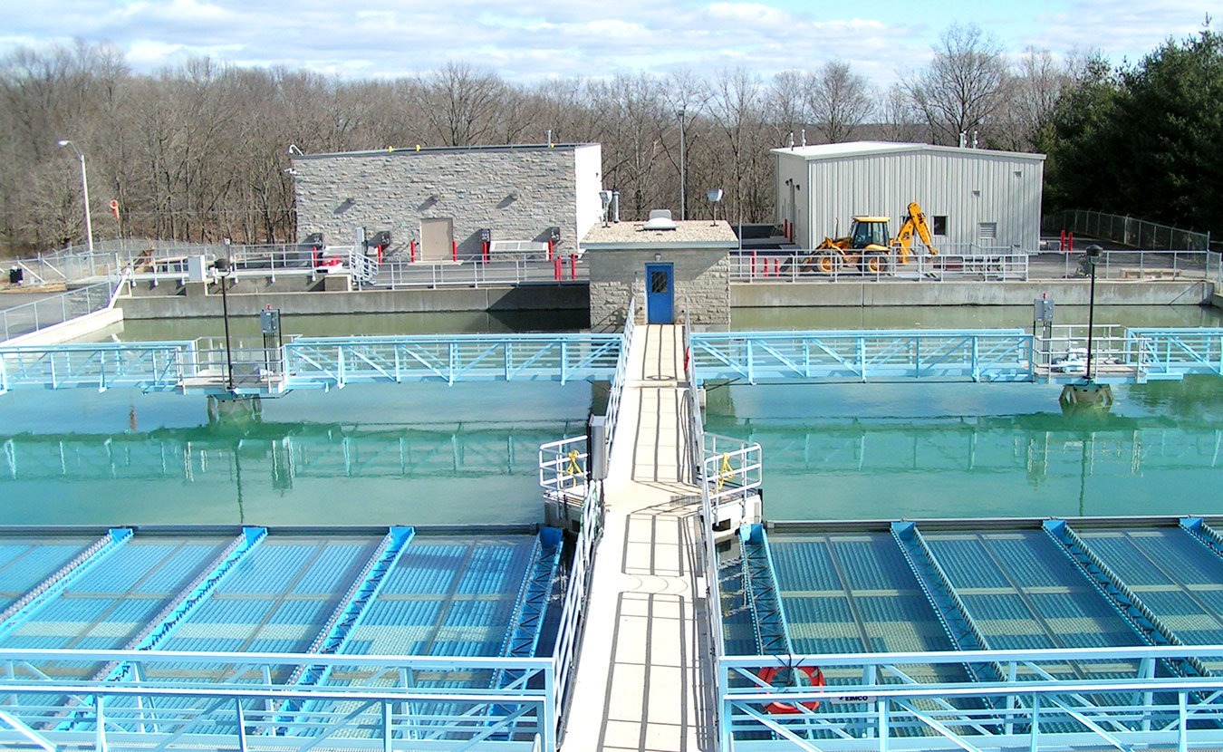 Two sediment basins at the Monroe Water Treatment Plant near Lake Monroe, Bloomington's water source. Journalist Michael Glab looked into reports about contaminants in Bloomington's water supply and discovered that drinking any water is a gambler's game. | Courtesy photo