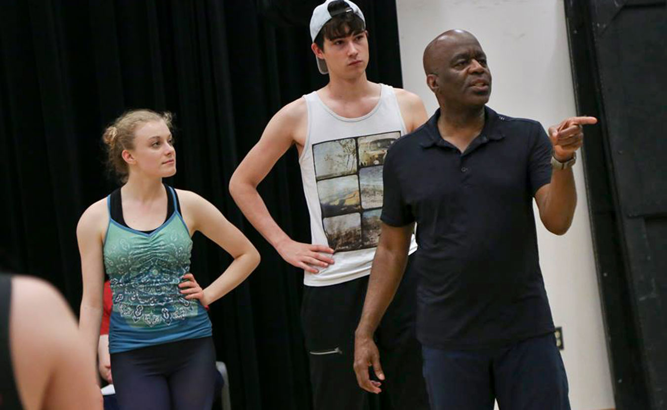 """Kenneth L. Roberson (right), director and choreographer of this summer's """"Dames at Sea"""" production by Indiana University Summer Theatre, instructs during a rehearsal. 