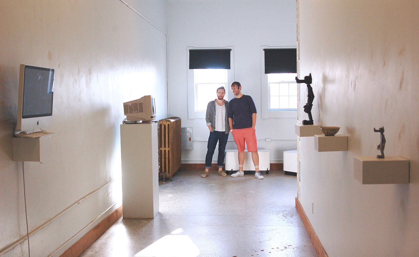 """Artists William Bass, left, and Raphael Cornford stand at the end of their downtown gallery space, NOISE. Writer Lindsay Welsch Sveen says a new art scene is emerging that offers """"hip alternatives to the institutions."""" 