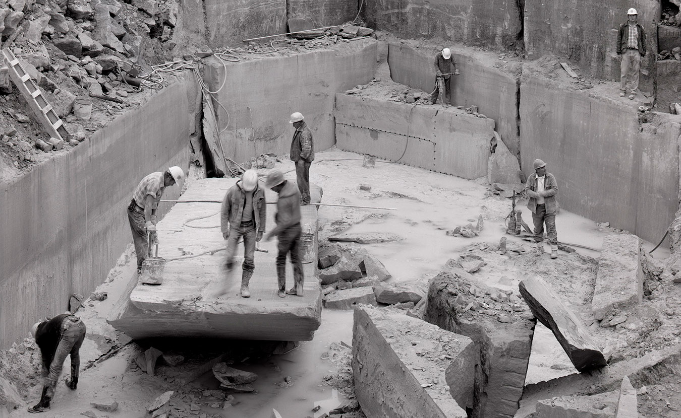 """This photo by Jeffrey Wolin shows the last day of quarry season at the Independent Limestone quarry in 1983. This is one of many photographs Wolin took for his book, with text by Scott Russell Sanders, on the Indiana limestone industry, """"Stone Country."""" 