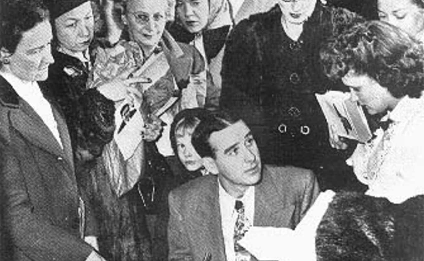 """Writer Ross Lockridge Jr. (RLJ) killed himself on March 6, 1948, just two months after his book """"Raintree County"""" was published. Pictured here, RLJ is signing autographs at an L. S. Ayres department store in Indianapolis on January 20, 1948. This is the last known photograph of RLJ. 