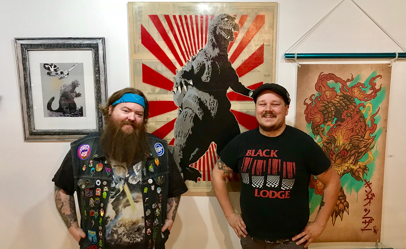 """New spaces — Delinquent Gallery & Tattoo KAIJU and Artisan Alley's Twisted — offer """"lowbrow"""" and boundary-pushing art in Bloomington, says writer Samuel Welsch Sveen. Comics, video-game-themed artwork, cult movies, and tattoos can be found at one; artist studios, a healing shaman, and a retail store for edgier artwork at the other. Pictured here are Delinquent Gallery & Tattoo KAIJU's owners, tattoo artist Chris McVillain, left, and curator Brian Aldridge, right, with art for their inaugural show, """"Kai-July."""" 