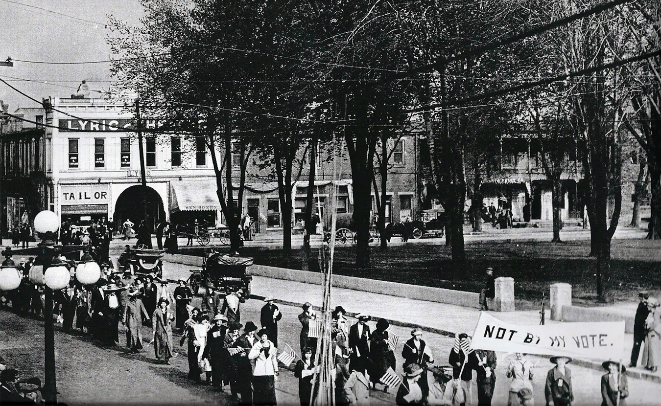 """Antoinette Leach was living in Sullivan County in 1893 when she became the first female lawyer in Indiana. While her law practice specializing in """"Commercial Law and Collections"""" prospered, she was also active in politics, including local and national suffrage associations. This photo is of a suffrage parade in downtown Sullivan that Leach likely organized. 