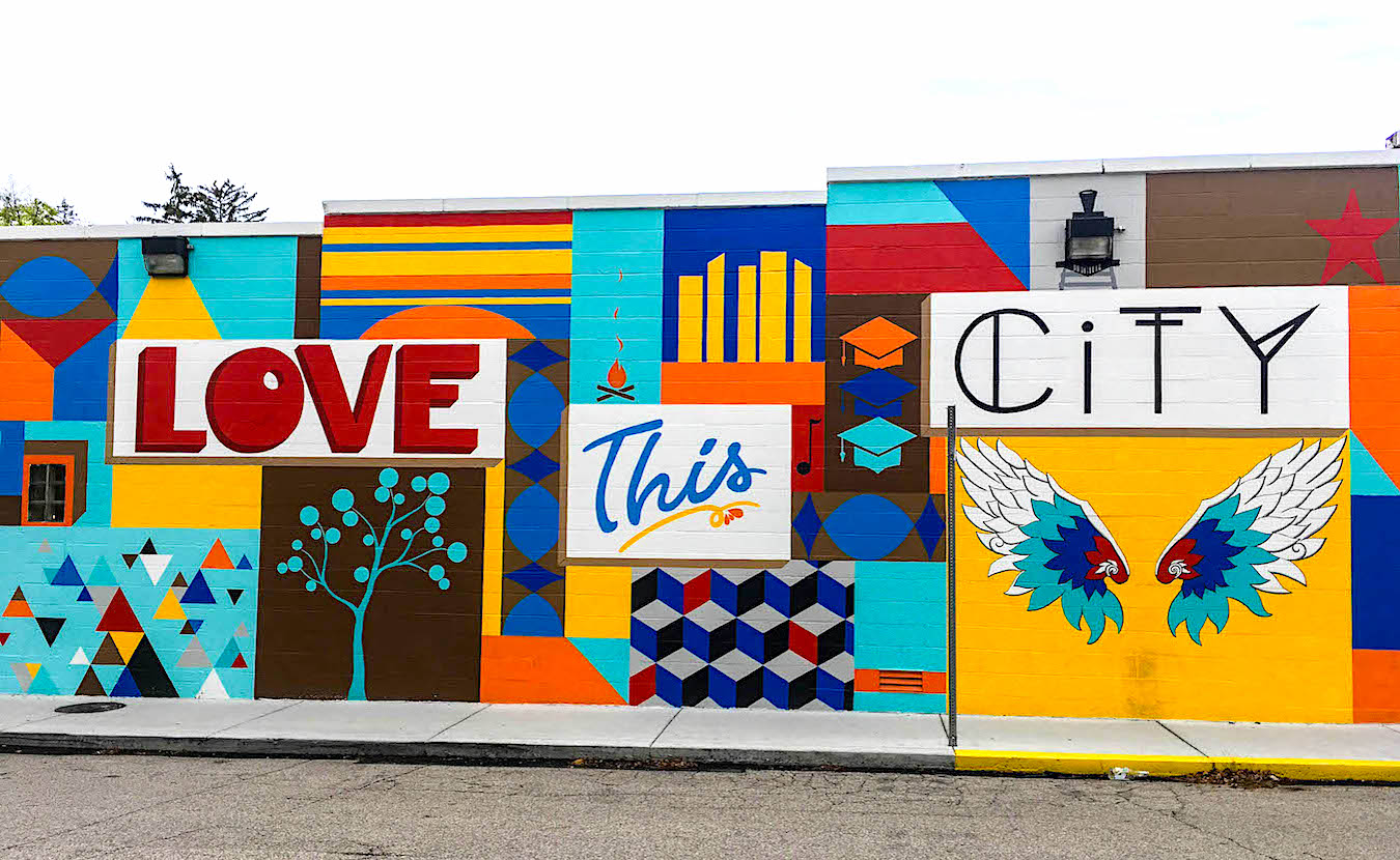 This mural, 'Love This City,' was painted by Eva Allen on the east-side location of Mother Bear's Pizza in spring 2019. M.J. Bower photographed more than 30 murals in Bloomington to create The Bloomington Mural Trail. | Photography by M.J. Bower