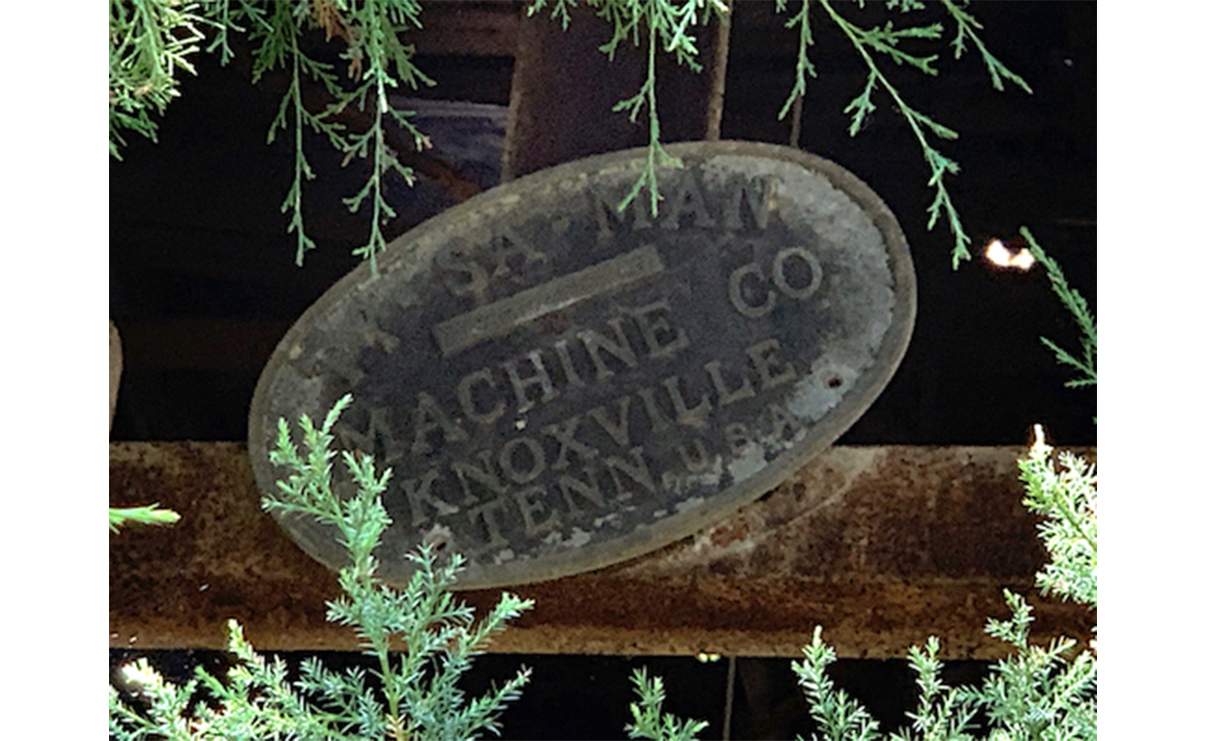 An industrial plate found at the mill on the property. | Photo by Geoff McKim