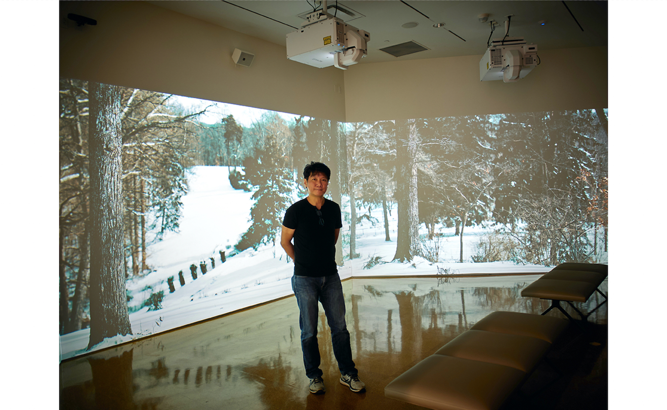 Liou with his new work, 'House of the Singing Winds,' a high-definition, multichannel video installation that shows the changing seasons at the historic home and studio of Hoosier painter T.C. Steele. Liou teaches in the Eskenazi School of Art, Architecture, and Design.   Photo by Paige Strobel