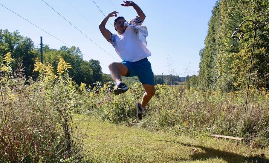 """Krista Detor wanted to create """"a destination"""" for artists. """"Make it an experience,"""" she says. """"You get writers block or you can't figure out a riff? Walk out into the woods, sit on a log, dance in the meadow."""" Here, theater resident César Pinzón does just that at The Hundredth Hill. 