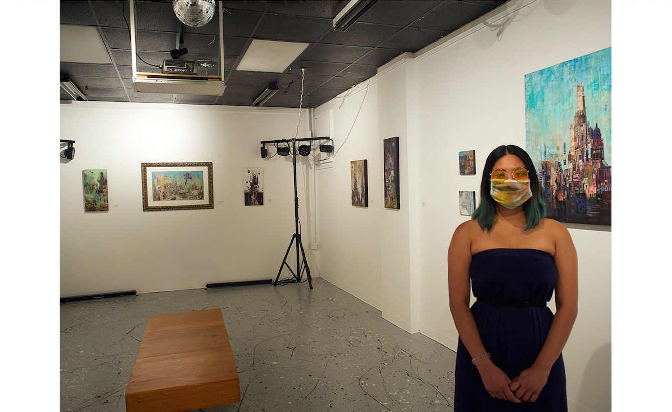 Diva Armas Luther, curator of Dimensions Gallery at Artisan Alley, says the gallery is offering online viewing of their artists' work and in-person viewing by appointment only. Artwork by Lydia Burris is currently on display.   Photo by Paige Strobel