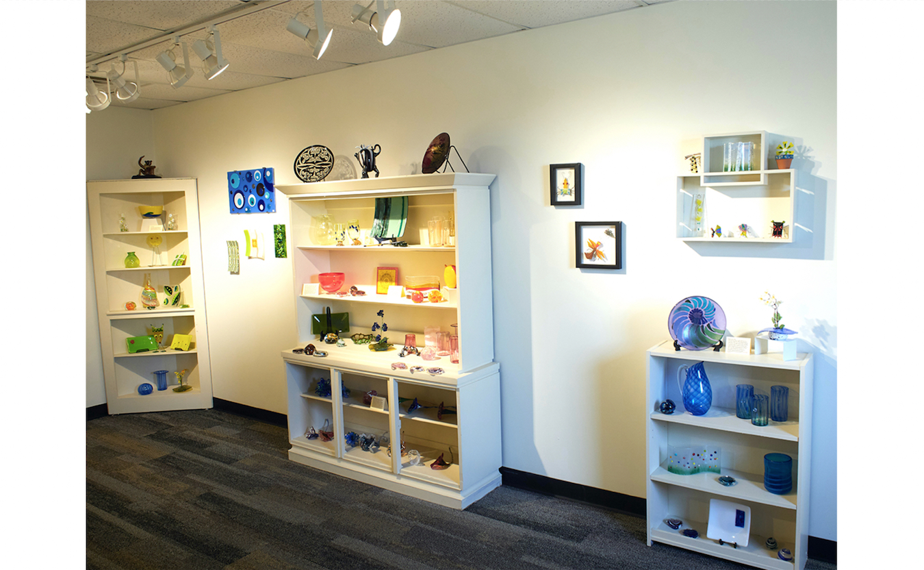 The gallery at Bloomington Creative Glass Center (BCGC) is open Wednesday through Friday, 1:30–5:30 p.m., and displays artist work with such diverse glass pieces such as blown glass, fused glass, sandblasted glass, molded glass, and more.   Photo by Paige Strobel