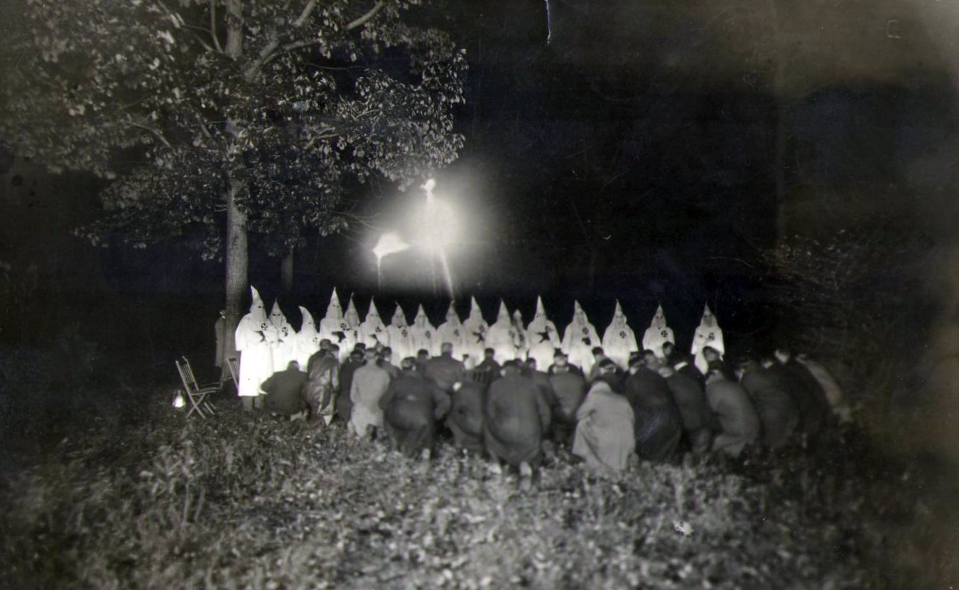 While the Ku Klux Klan in Indiana peaked nearly 100 years ago, its members' support of Christian nationalism is reflected in various political, militia, and hate groups today. Writer Laurie D. Borman interviewed several experts who suggest the ideologies espoused by today's far-right groups is a continuation of the country's racist past. This photo is of a KKK cross burning in northern Indiana in 1922.